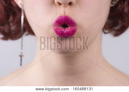 Close Up Of Red Glossy Female Lips Kissing