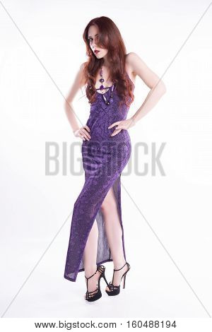 fashion model with violet dress isolated over white bacground