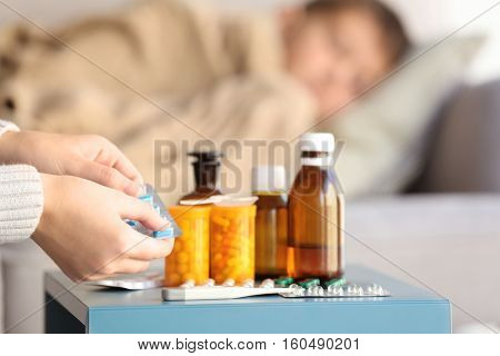 Woman taking care of small sick boy