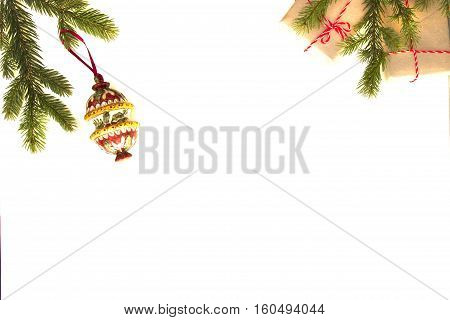 Christmas composition. Green fir twings, Xmas gifts and decoration on white background. Top view, flat lay. Copy space for text. Winter holidays concept