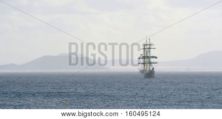 Square Rigged Tall Ship with the Northern Coast of Fuerteventura and the Island of Lobos in the Background