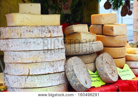 COMO, ITALY - DECEMBER 2, 2016: Stall with traditional italian cheese on Christmas market in Como