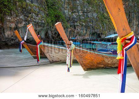 Tropical beach traditional long tail boats famous Maya Bay Thailand