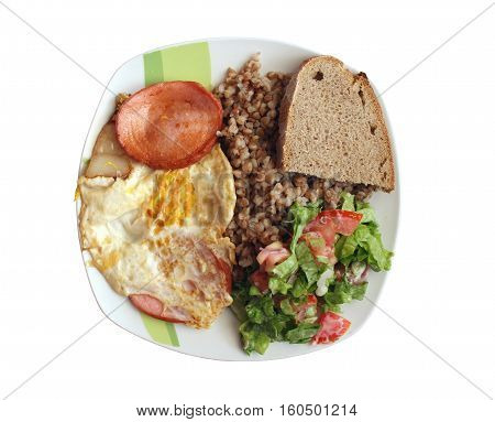 Dish from boiled buckwheat dried egg and sausage on the plate