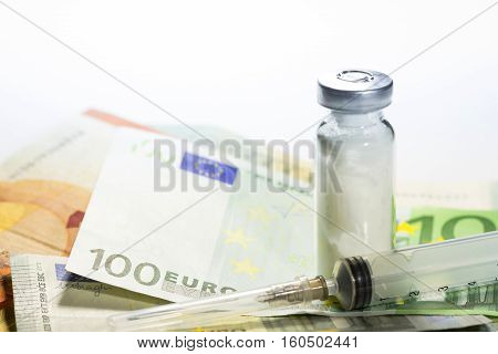 Euro banknotes with medical instruments and pills