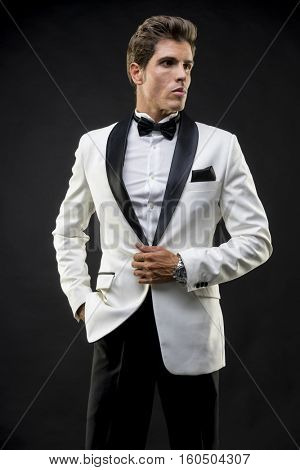 Evening, Elegant and handsome man dressed in tuxedo for New Year's Eve or party