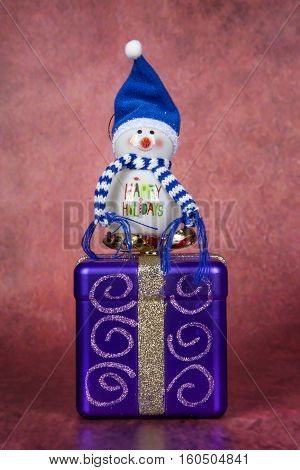 A happy holiday ornament and gift box for Christmas