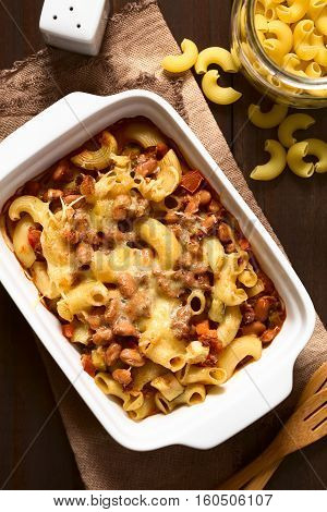 Chili con carne and macaroni pasta casserole in baking dish photographed overhead with natural light (Selective Focus Focus on the top of the dish)