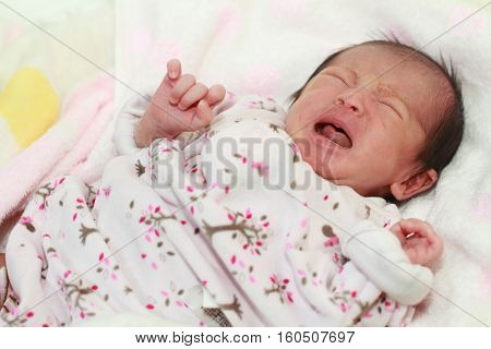 Crying Japanese new born baby girl (0 year old)