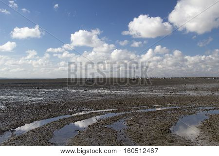 Reflection of clouds on the beach at Leigh-on-Sea near Southend Essex England