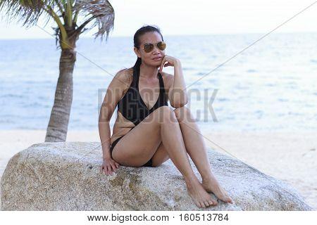 Lady relax pretty in Ban Krut Beach at Prachuap Khirikhun Province Thailand