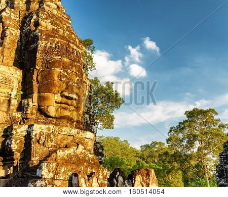 Giant Stone Face Of Ancient Bayon Temple, Angkor Thom, Cambodia