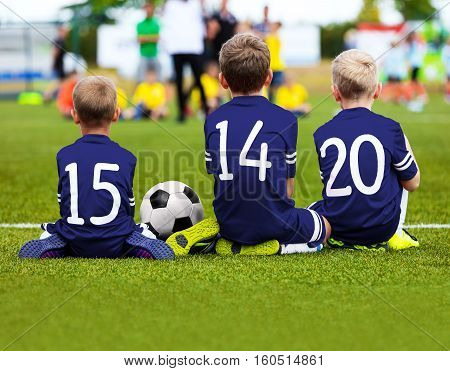 Football Game for Kids. Young Boys Soccer Players Athletes. Children Football Players at Match with Ball. Soccer Bench of Youth Team. Footballers in Blue Sportswear