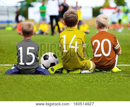 Football Game for Kids. Young Boys Soccer Players Athletes. Children Football Players at Match with Ball. Soccer Bench of Youth Team. Footballers in Golden Silver and Bronze Sportswear. Olympic Football