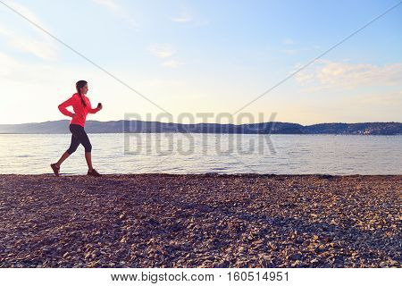 Young Fitness Woman Running Outdoors Near Sea.