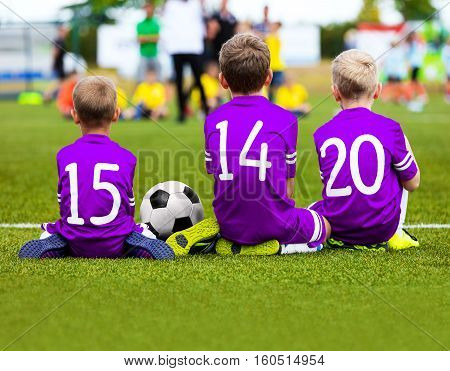 Football Game for Kids. Young Boys Soccer Players Athletes. Children Football Players at Match with Ball. Soccer Bench of Youth Team. Footballers in Purple Sportswear