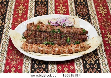 Grilled mixed meats on spit kebab. Close up view.