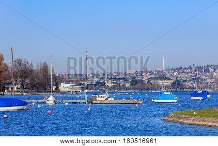 Zurich, Switzerland - 21 January, 2016: boats on Lake Zurich, the city of Zurich in the background. Zurich is the largest city in Switzerland and the capital of the Swiss Canton of Zurich.