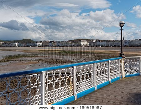 View of the beach and promenade from the pier at Llandudno Gwynedd Wales.