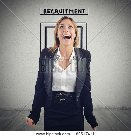 Woman exits from the room of recruitment exults happily because she is hired