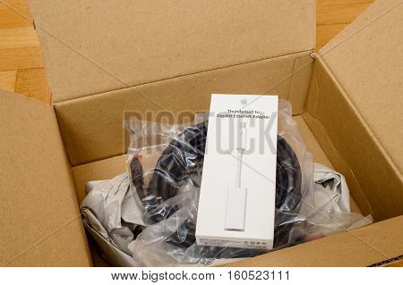 PARIS FRANCE - SEP 12 2016: White digital computer cable for thunderbot to ethernet cable with Ethernet cable insinde Amazon Prime cardboard box after unboxing