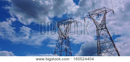 Electrical Power Line Against Cloud And Blue Sky