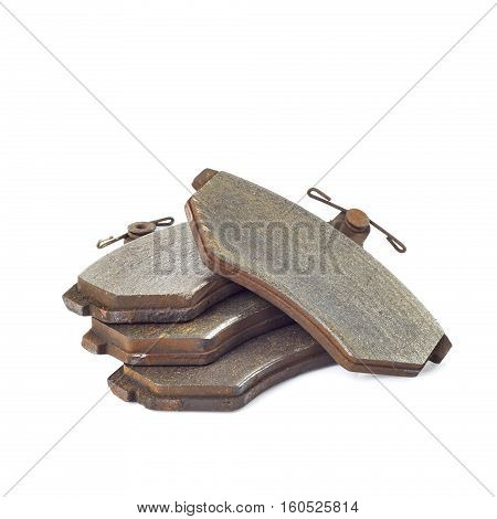 Old brake pads disk brake isolated on a white background stack