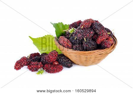 ripe mulberry fruit in bamboo basket on white background