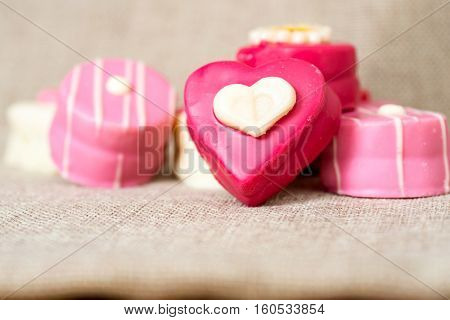 Composition for Valentine's day with small heart chocolates - ideal for your valentine's design