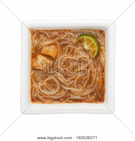 Peranakan food - Mee siam in a square bowl isolated on white background