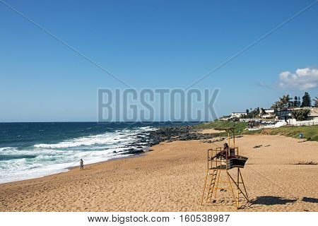 Beach Against Commercial And Residential Buildings And Blue Sky