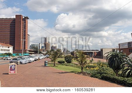 Empty Paved Promenadeand And Blue Cloudy Sky
