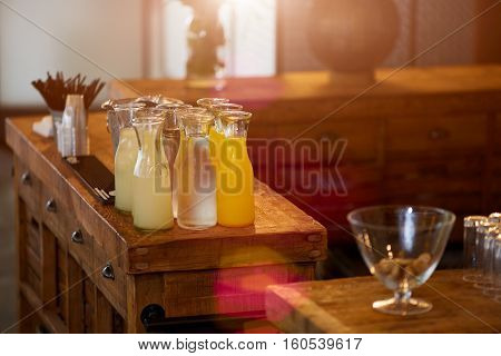 glass decanters with orange and lemon juice and grapefruit on the bar