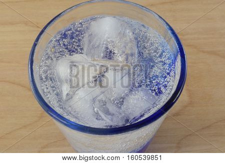 Close up of lemon lime soda pop in glass with ice cubes