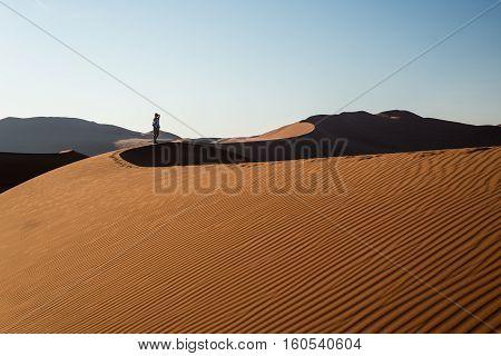 Tourist Holding Smart Phone And Taking Photo At Scenic Sand Dunes At Sossusvlei, Namib Desert, Namib