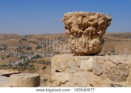Weathered column capital on the ruins of medieval Kerak castle in Jordan