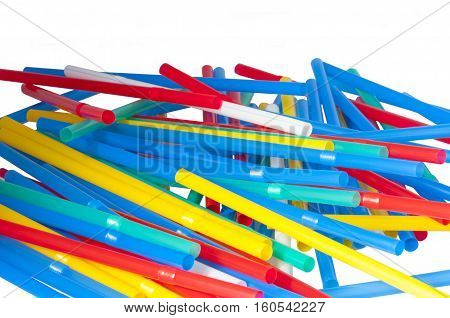 multi-colored tubules for cocktail are put in a small small group on a white background