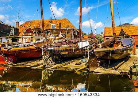 Traditional Dutch Botter Fishing Boats on the Dry Dock in the Harbor of the historic village of Spakenburg-Bunschoten. The village was once a major fishing center on the now dammed IJselmeer