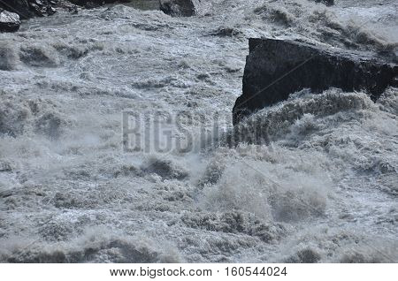 Inguri River. Georgia. Strong current and high level in the river.