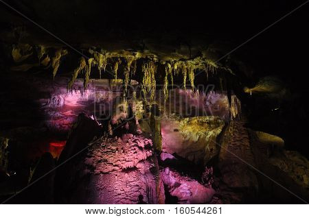 Prometheus Cave. Georgia. Stalactites and stalagmites highlighted colors.