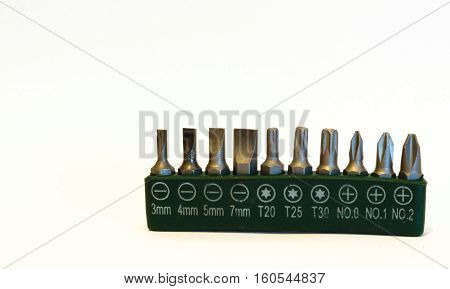 Kit of 10 screw bits isolated with green case