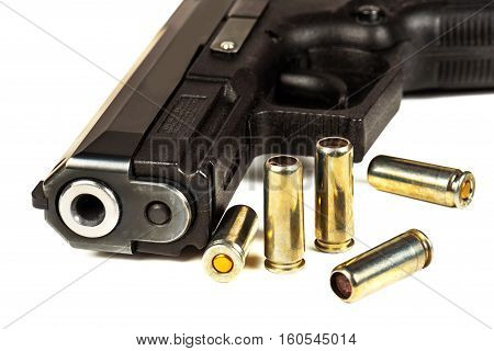 The black gun and cartridges to him on a white background close up.