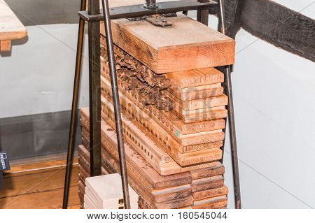 Old cigar press made of wood for pressing and drying the finished rolled cigars.