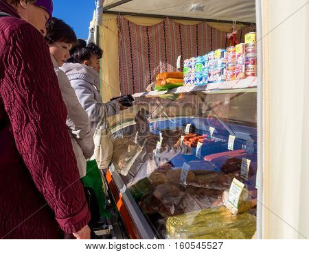 Yalta, Russia - November 13, 2015: People buy products on the street the point of sale