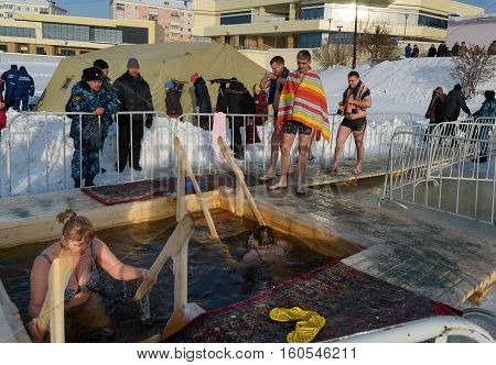 People Bathe Into Cold Water Of Ice-hole On Epiphany Day. Russia