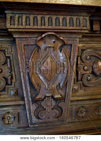 Carved antique furniture design element in the shape of an owl