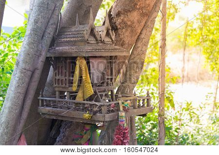Ancient Thai outdoor spirit house shrine Thai style made from wood. In tradition Thailand all spirit houses are kept outdoor for protect house.