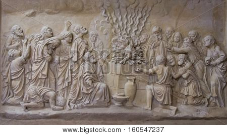 Bas-relief depicting the priests of Baal and fire falling from the sky to the altar in the Carmelite Monastery in Muhraqa on Mount Carmel Israel