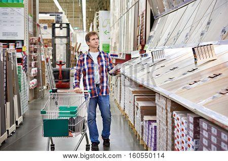 Man Chooses Floorboard For Home Renovation