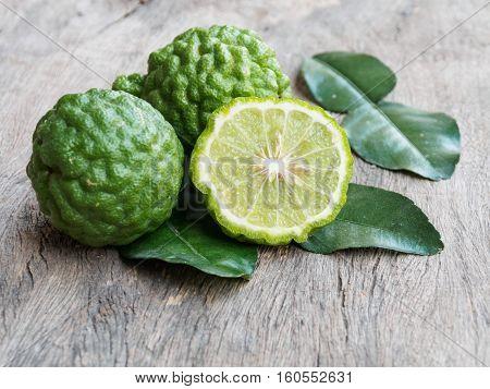 Fresh kaffir lime fruit on rustic wooden background